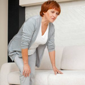 Woman Showing Signs of Achy Joints Arthritus Pain